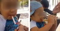 VIDEO: Padre le enseña a fumar y tomar cerveza a su bebé y se gana el repudio de la web
