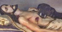 Duerme en un altar junto a una imagen de Jesús y conmueve a las redes sociales
