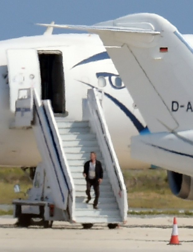 A man believed to be the hijacker of the EgyptAir Airbus A-320, which was diverted to Cyprus, leaves the plane before surrendering to security forces after a six-hour standoff on the tarmac at Larnaca airport's largely disused old terminal on March 29, 2016.  The hijacker who seized the Egyptian airliner and forced it to land in Cyprus has been detained, Cypriot government spokesman Nicos Christodoulides said. / AFP PHOTO / GEORGE MICHAELGEORGE MICHAEL/AFP/Getty Images
