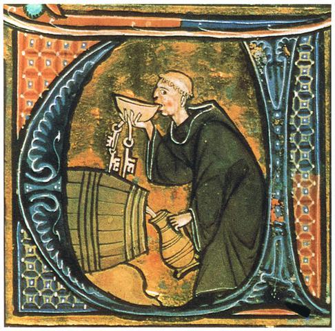 Monje bebiendo de un pocillo