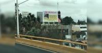 Mujer se vengó del hombre que la dejó embarazada con un gigantesco cartel en un edificio